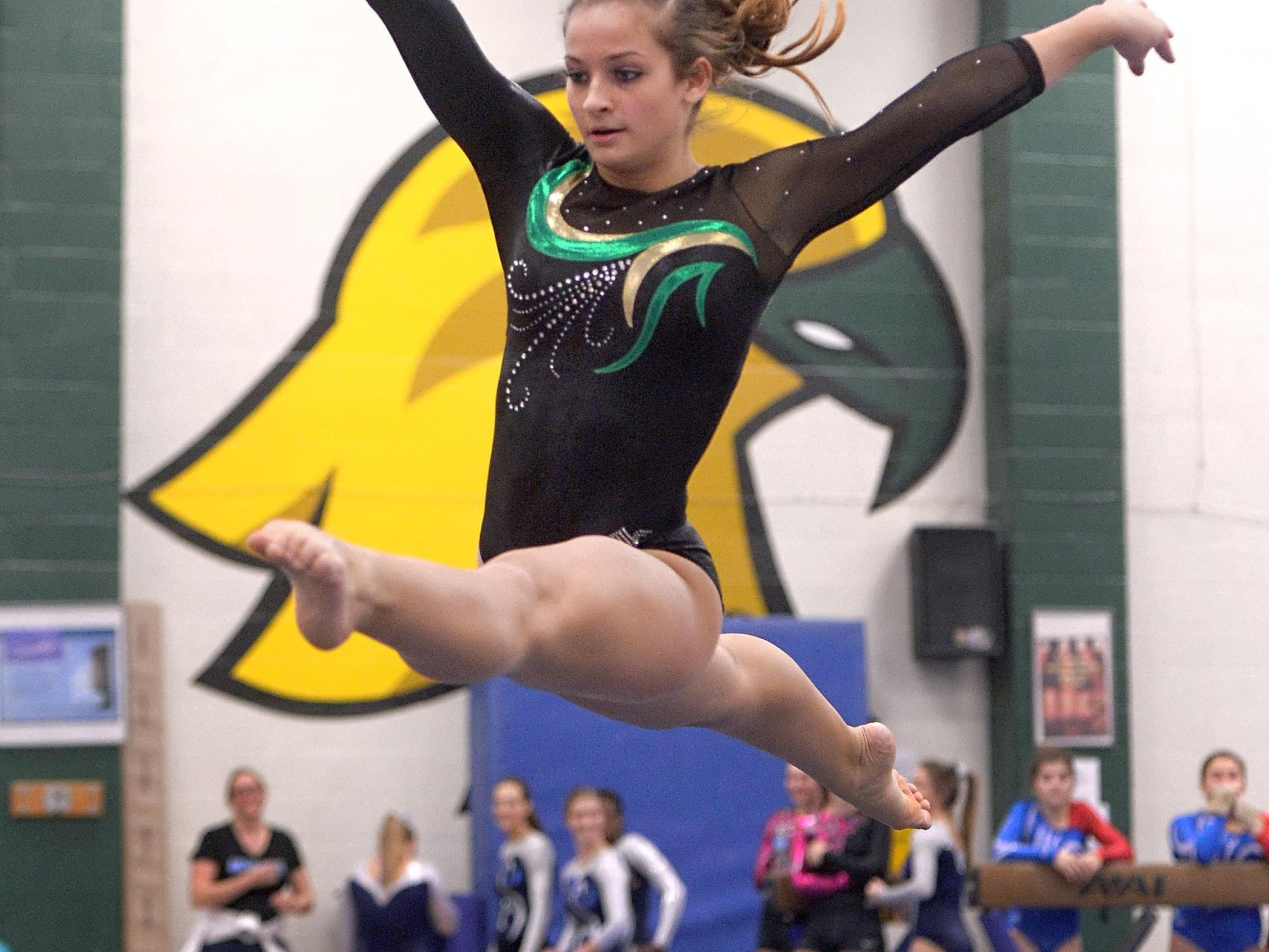 Hilton's Ariana DiNato performs her floor routine during the Section V Gymnastics Championships & State Qualifier held at SUNY Brockport on Friday.
