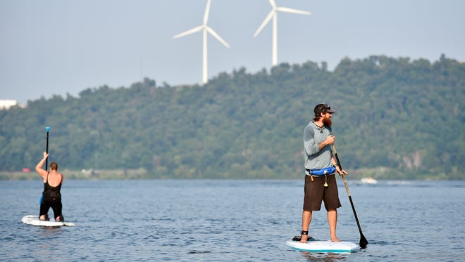 "Shank's Mare Outfitters instructor Josh Hill, right, directs students in stand-up paddle board techniques in the Lake Clarke section of the Susquehanna River Thursday, July 20, 2017, in Lower Windsor Township. Stand-up paddle boarding, frequently abbreviated to ""SUP,"" has enjoyed a surge in popularity in the past five years."