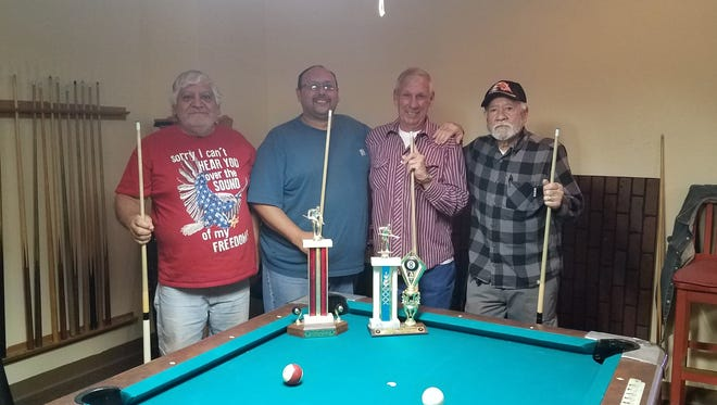 The Friendship Pool winners for February are from left to right are second place VFW members Joe Lujan and Joe Herrera; and first place Elks members John Andre and Andy Nejeres.