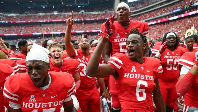 Sep 3, 2016; Houston, TX, USA; Houston Cougars cornerback Howard Wilson (6) celebrates with teammates after the Cougars defeated the Oklahoma Sooners 33-23 at NRG Stadium. Mandatory Credit: Troy Taormina-USA TODAY Sports