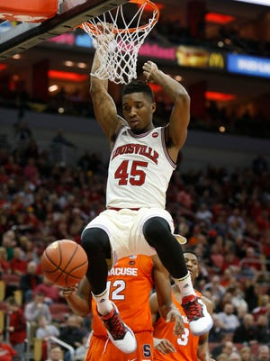 Louisville's Donovan Mitchell slams home two of his 25 points agianst Syracuse. Feb. 26, 2017.