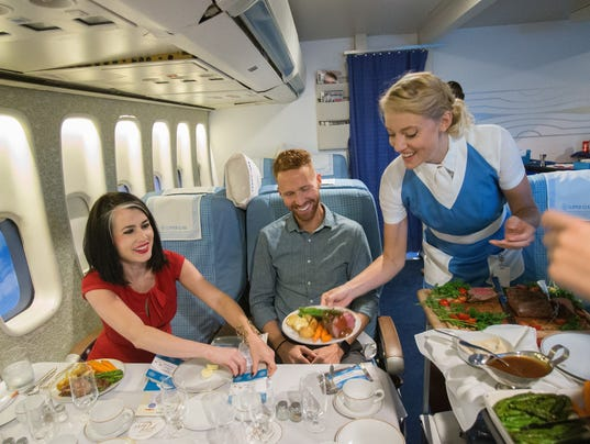 Stewardess Chandra Brenner serves the Clipper Class cabin.