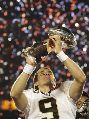 New Orleans Saints quarterback Drew Brees holds the Vince Lombardi Trophy aloft after the NFL Super Bowl XLIV football game in Miami, Sunday, Feb. 7, 2010. The Saints won 31-17. (AP Photo/Paul Sancya)