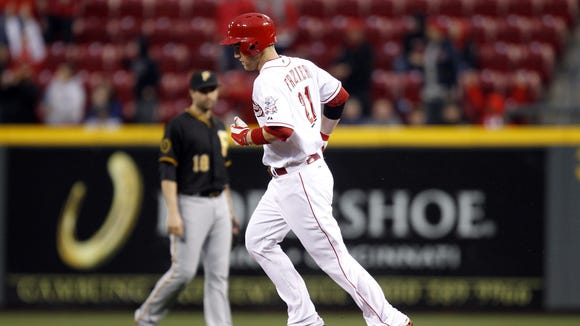 Todd Frazier runs the bases after hitting a home run off  the Pirates' Wandy Rodriguez in the first inning at Great American Ball Park.