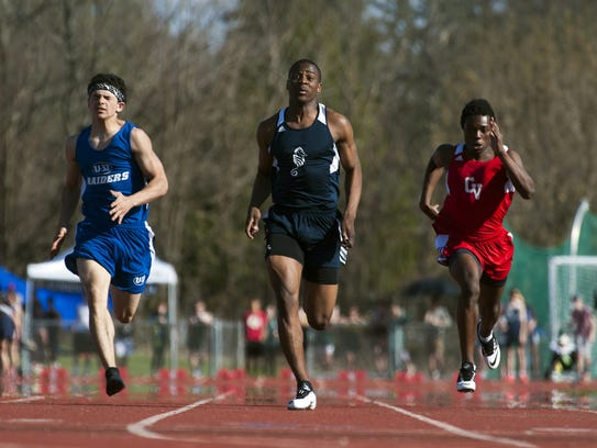 Burlington's Ahmed Noor leads the pack of runner in