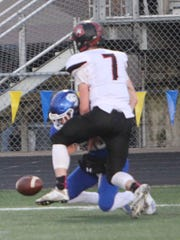Santiam's Sean Horning (7) breaks up a pass intended