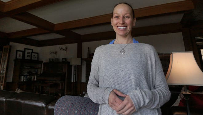 Jo Gassner, shown in this file photo in her home, opened Fearless Yoga with the idea that people need to put more play back in their lives.
