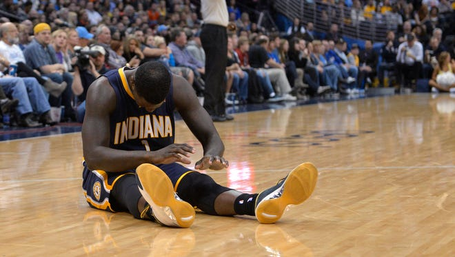 Indiana Pacers guard Lance Stephenson reacts to turning over the ball to the Denver Nuggets during the fourth quarter, Jan. 25, 2014, in Denver.
