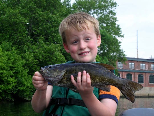 Family photograph of Concord High graduate Jackson Staib as a young boy fishing.