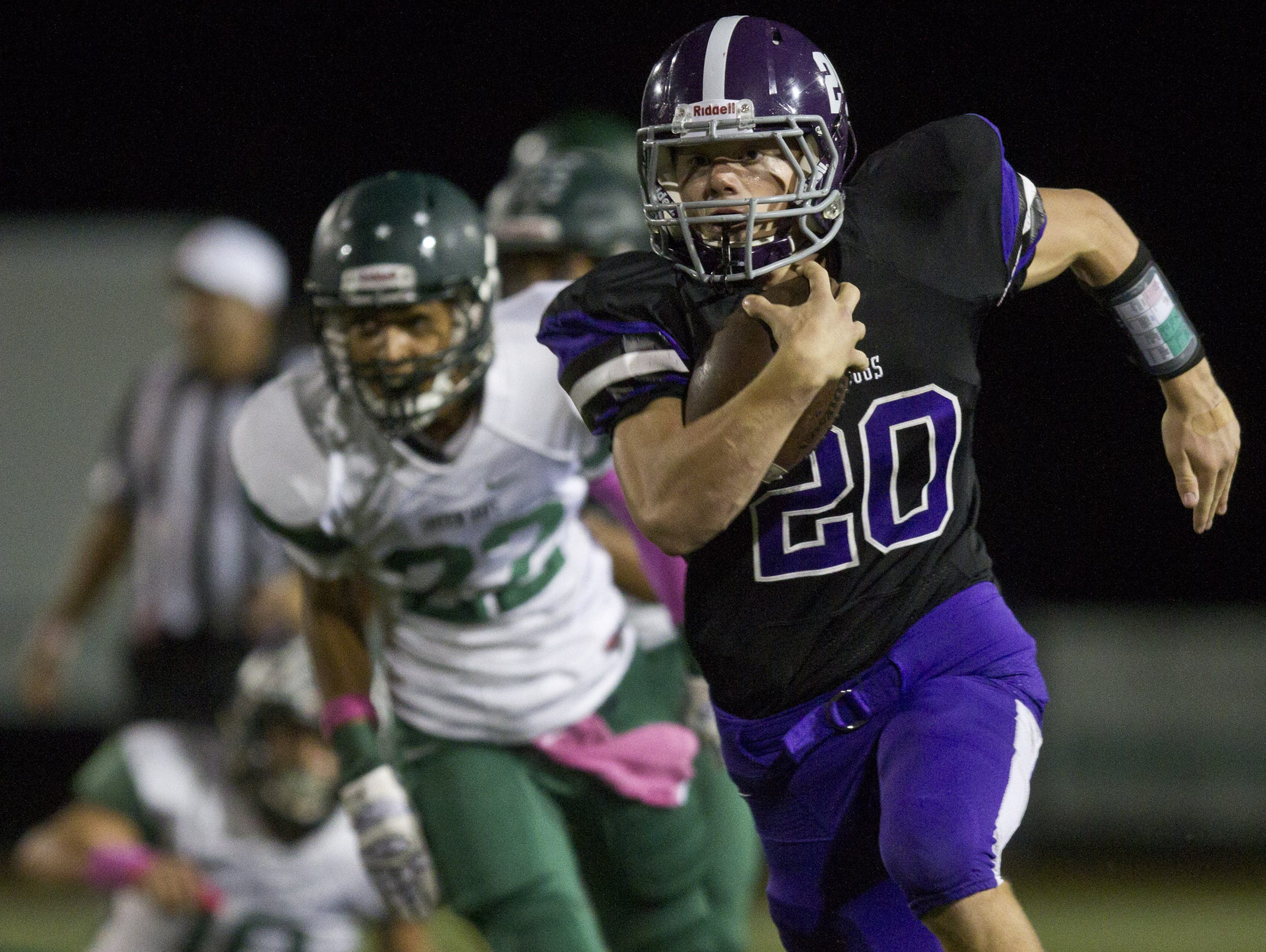 Rumson-Fair Haven running back Bryan Hess (No. 20), shown running against Long Branch on Oct. 9, will be a key player for the Bulldogs against Shore on Thursday.