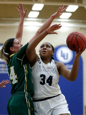 Lawrence University's Kenya Earl (34), one of the top freshman in the Midwest Conference, is the daughter of former NBA player Acie Earl.