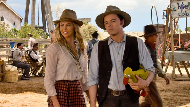 "In ""A Million Ways to Die in the West"" starring Seth MacFarlane and Charlize Theron, MacFarlane sends up Westerns directing and starring as a milquetoast farmer who falls for a new girl (Theron) in town, but he winds up on the to-kill list of her gunslinger spouse (Liam Neeson)."