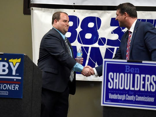 Vanderburgh County Commissioner candidates Sean Selby and Ben Shoulders shake hands after a debate at the Evansville Courier & Press in Evansville Wednesday.