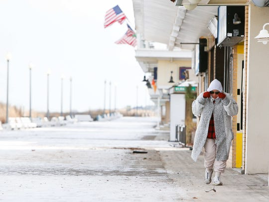 Despite the 10 degree wind chill, Nemesia Potter, 84, of Rehoboth still went on a walk to the empty and frozen boardwalk at Rehoboth Beach.