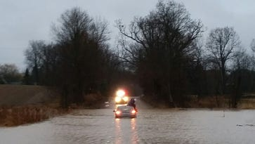 Flooded roads remain but rain on the way out of Livingston County