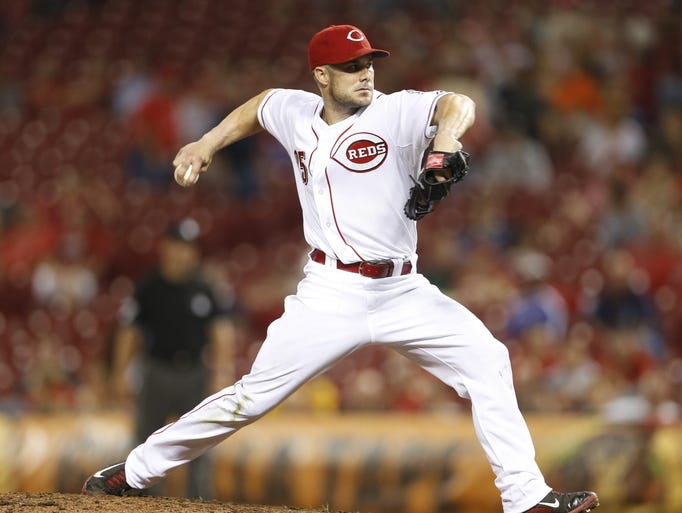 Cincinnati Reds Skip Schumaker (25) pitches during the ninth inning of their game played at Great American Ball Park in Cincinnati, Ohio Thursday.