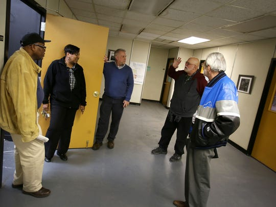 From left, Robert Wilson, Telegram Newspaper owner Gina Steward, River Rouge Community Development Director Karl Laub, Former C-Pop Gallery owner Rick Manore and River Rouge City Councilman Daniel Cooney talk inside the offices of the Telegram Newspaper building on West Jefferson Avenue on Wednesday, March 1, 2017. Cooney, Laub, Manore and a group of people are leading an effort to market vacant properties in River Rouge such as the small office/ studio spaces inside the Telegram Newspaper building to displaced tenants of the Russell Industrial Center.