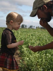 Jacob Cowgill and his daughter Willa take samples from