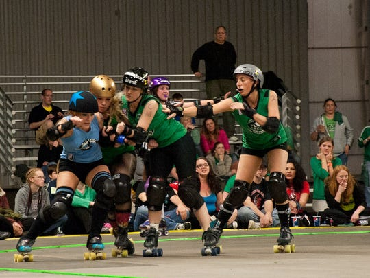 Mid Iowa Rollers take on the Des Moines Derby Dames. <cutline_credit>register file photo</cutline_credit>