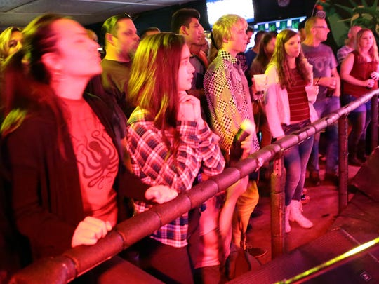 Crowd members watch as Palm Desert indie band Caxton performs during the second Tachevah Band Showcase at The Hood Bar and Pizza on Wednesday night in Palm Desert.