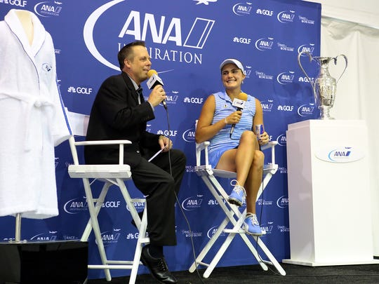 LPGA communications director Kraig Kann (left) interviews defending champion Lexi Thompson on Tuesday, March 31, 2015 during a press conference at the ANA Inspiration at Mission Hills Country Club. Thompson won last year's Kraft Nabisco Championship by three strokes; it was her first major championship. The tournament has since changed names and title sponsors.