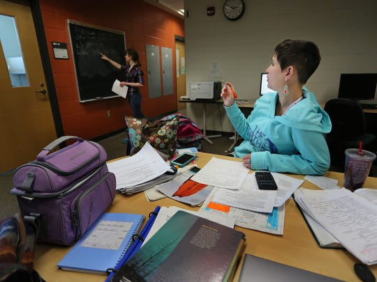 Elizabeth Fritz, left, and Samanta Wirkus, both of Wausau, work on a problem together as they study for a chemistry exam at the University of Wisconsin-Marathon County, Thursday, February 12, 2015.