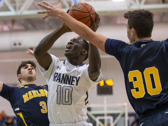 Ranney's Ahmadu Sarnor goes up with shot against Marlboro's Ryan LcRocca and Dylan Kaufman during first half action. Toms River North vs Mater Dei in Shore Conference Boys Basketball Semifinal in Toms River on February 21, 2017.