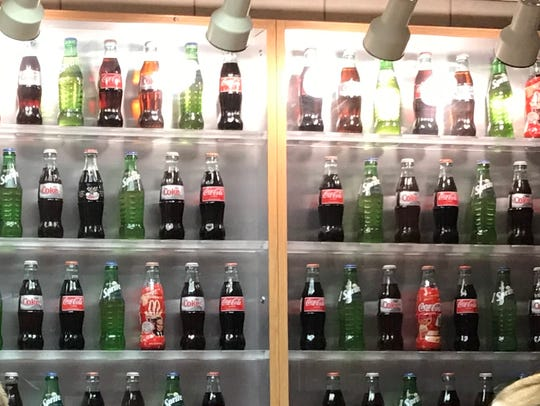 The McDonald's at Des Moines' Mercy Hospital promotes its sugary soft drinks in bar-like fashion.