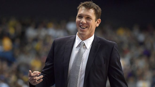 Los Angeles Lakers head coach Luke Walton reacts against the Denver Nuggets at Citizens Business Bank Arena.