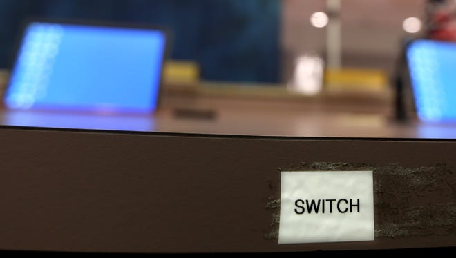 This small sign reminds Mayor John Marks that he can turn off the microphone of a citizen speaking to the City Commission.   Mike Ewen/Democrat A switch sign is a reminder for Mayor John Marks of his ability to turn a microphone off if he believes it is necessary.