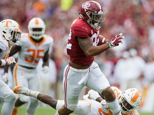 Alabama tight end Irv Smith Jr. (82) carries against Tennessee in first half action at Bryant-Denny Stadium in Tuscaloosa, Ala. on Saturday October 21, 2017. (Mickey Welsh / Montgomery Advertiser)