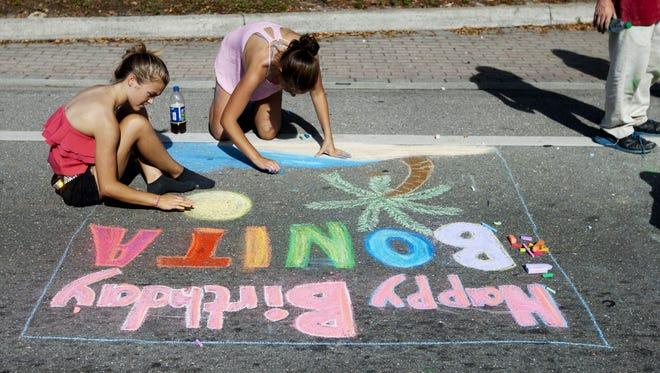 Julia Rodriguez, 14, left, and McKaelen Larsen, 14, celebrate the birthday of Bonita Springs at Riverside Park at last year's Celebrate Bonita! event.