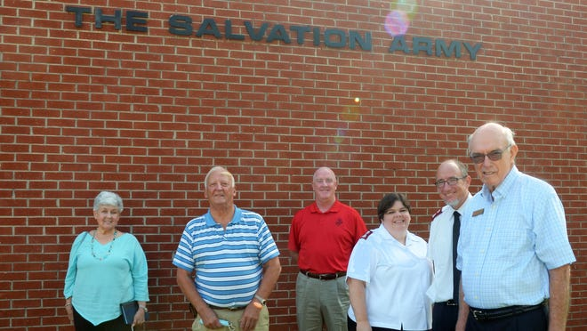 Salvation Army members Linda Thomas, Bill Taylor, Paul Mcelearney, Maj. Sara Kratz, Maj. Curtis Kratz, and Jim Davis stand in front of the organization office on North Craven Street Wednesday. Like other relief organizations in Craven County, the Salvation Army Church has been impacted by the ongoing COVID-19 crisis.
