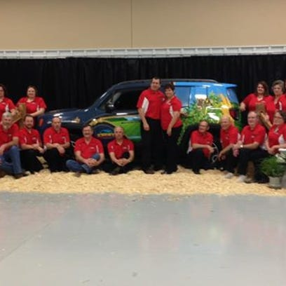 """Randy and Renee Ebert with their car, """"Ag ProMotor, """" will host Kewaunee County's Farm Technology Days 2017, which is expected to bring up to $1.5 million in sales to local businesses."""