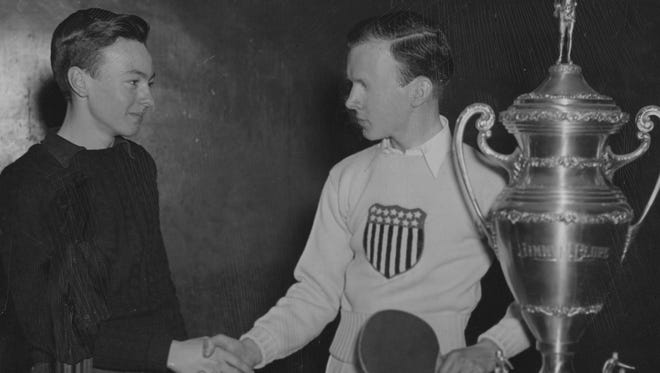 Jimmy McClure, right, shakes hands with a fellow table tennis player, Charles Tichenor, March, 1940.