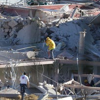 Rescuers work at the hospital.
