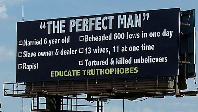 A billboard insulting the Prophet Muhammad on I-465 South near the Washington Street exit has sparked outrage, Tuesday, June 6, 2017.