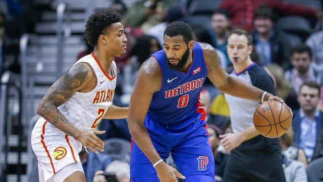 Detroit Pistons center Andre Drummond dribbles against Atlanta Hawks forward John Collins in the second half at Philips Arena in Atlanta on Dec. 14, 2017.