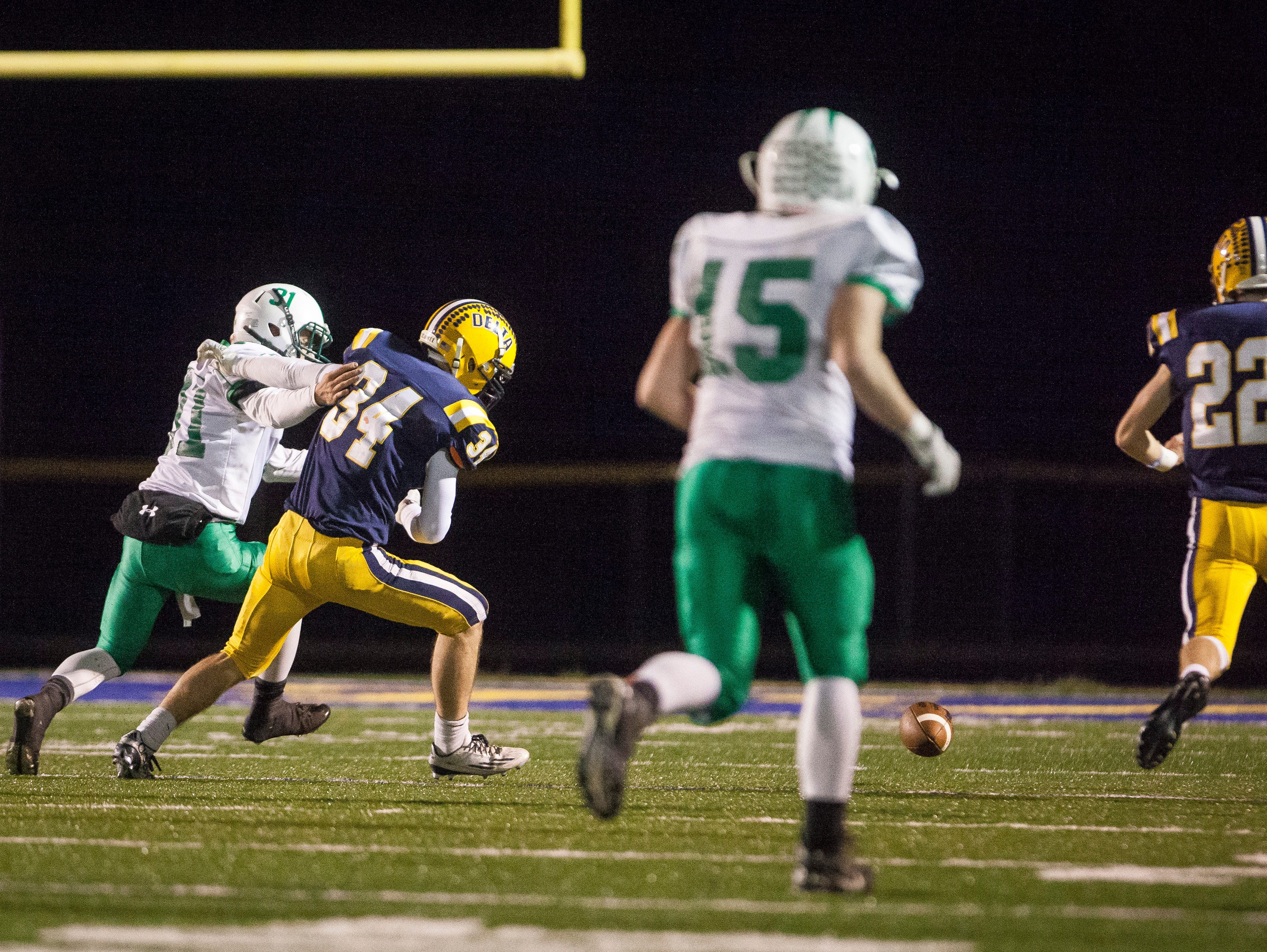 Delta's defense recovers a bad snap from New Castle's offense Friday night. Delta won with a final score of 49-7.