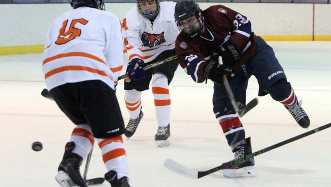 The Harvey School's Cian Keohane fires off a shot past White Plains' Ethan Klipstein during their game at the Guy Mathews Thanksgiving Invitational Hockey Tournament at Ebersole Ice Rink in White Plains, Nov. 25, 2016.