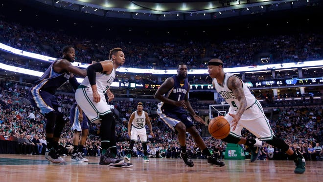 Boston Celtics guard Isaiah Thomas (4) drives the ball against Memphis Grizzlies forward Lance Stephenson (1) in the second half at TD Garden in March of 2016.