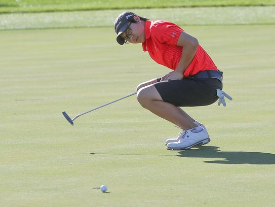 John Kim of Palm Desert reacts to a missed putt at