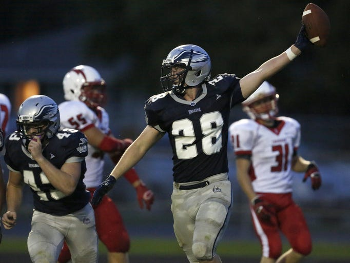 Menasha High School's Isaac Erdmann celebrates after Menasha blocked a punt in the second quarter against Seymour High School during their football game at Calder Stadium on Friday, August 29, 2014, in Menasha, Wis.