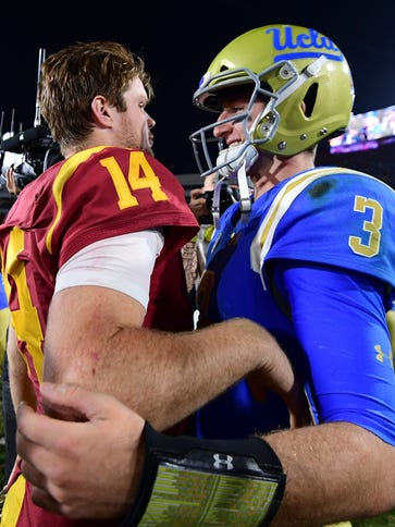 Josh Rosen #3 of the UCLA Bruins and Sam Darnold #14
