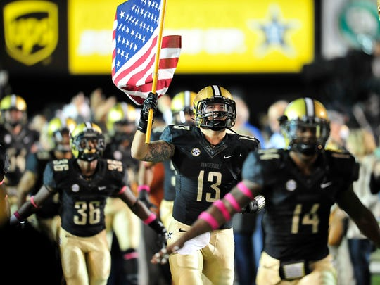 Vanderbilt's Jake Sealand (13) and other players take
