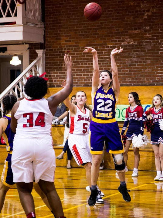 in the basketball game between OC and ASH in Grand Coteau, Louisiana on November 14, 2017.