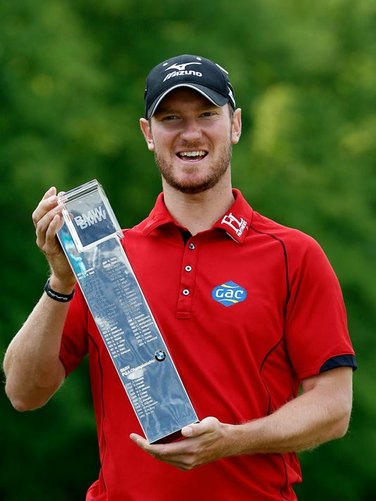 England's Chris Wood holds the trophy after winning the PGA Championship at Wentworth Club, in Virginia Water, England, Sunday May 29, 2016.  Wood shot a front-nine 29 before overcoming a late run of bogeys to win the PGA Championship by one stroke for the biggest victory of his career on Sunday. (Steve Paston / PA via AP) UNITED KINGDOM OUT - NO SALES - NO ARCHIVES