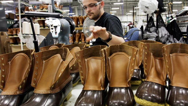 Eric Rego stitches boots in the facility where LL Bean boots are assembled in Brunswick, Maine. L.L. Bean is kicking it up a notch as demand continues to surge for its iconic boot. The Maine-based outdoors retailer has leased a 110,000-square-foot building and plans to install a third injection-molding machine. The company is boosting production to meet demand that's expected to reach 1 million pairs in 2018.