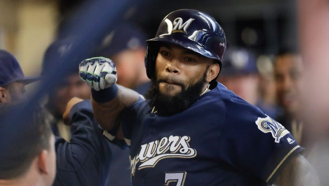 Eric Thames celebrates his first of two home runs.