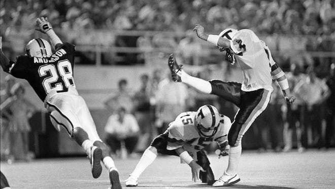 Vanderbilt's Thanh Anderson (28) is too late to stop the extra point effort of Tulane place kicker Dan Guirl (7) on Sept. 20, 1986.